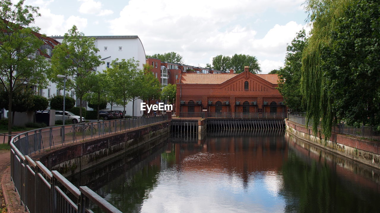 built structure, architecture, building exterior, water, tree, sky, reflection, cloud - sky, no people, day, outdoors, waterfront, covered bridge, nature
