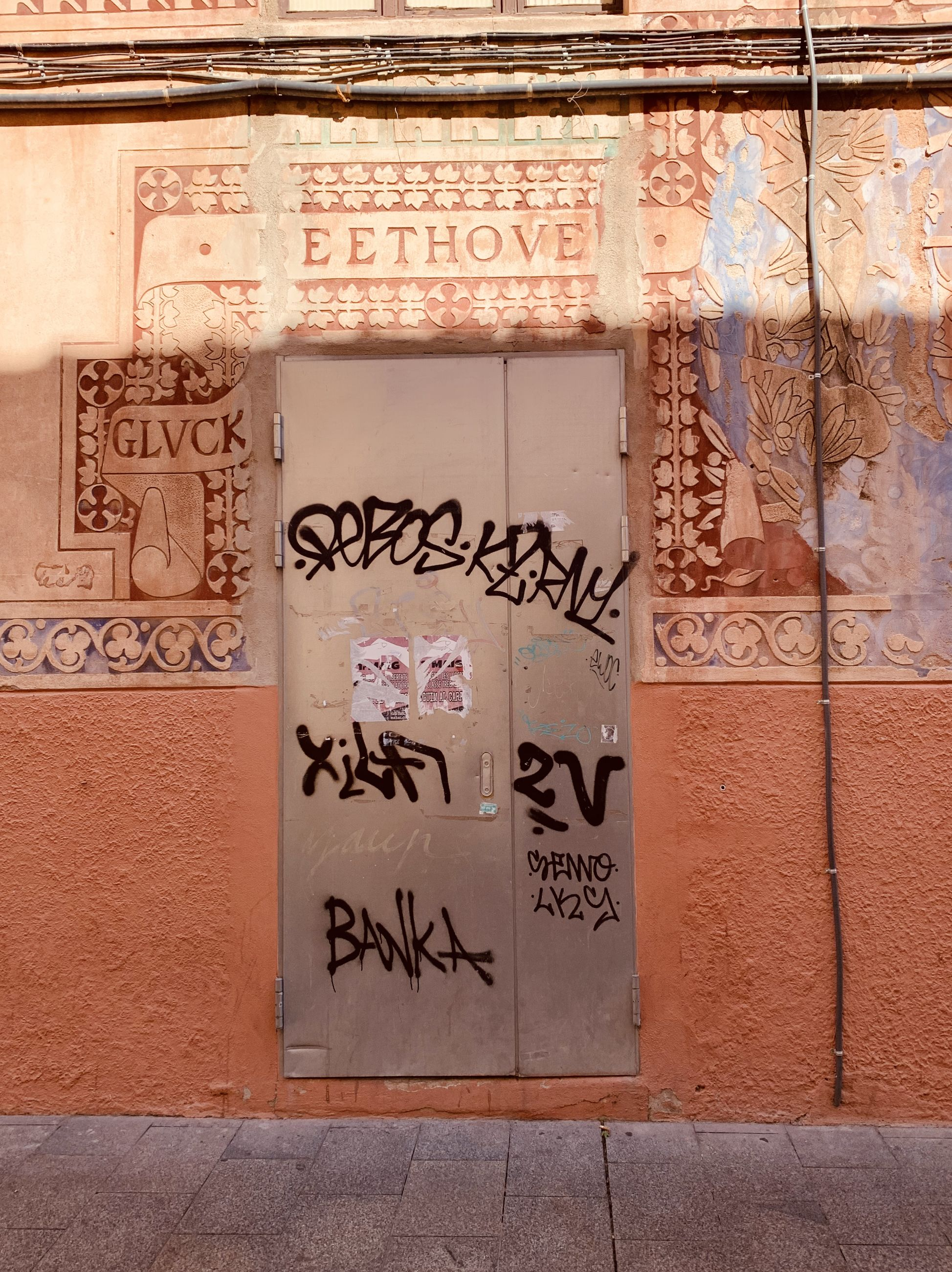 TEXT ON WALL WITH GRAFFITI