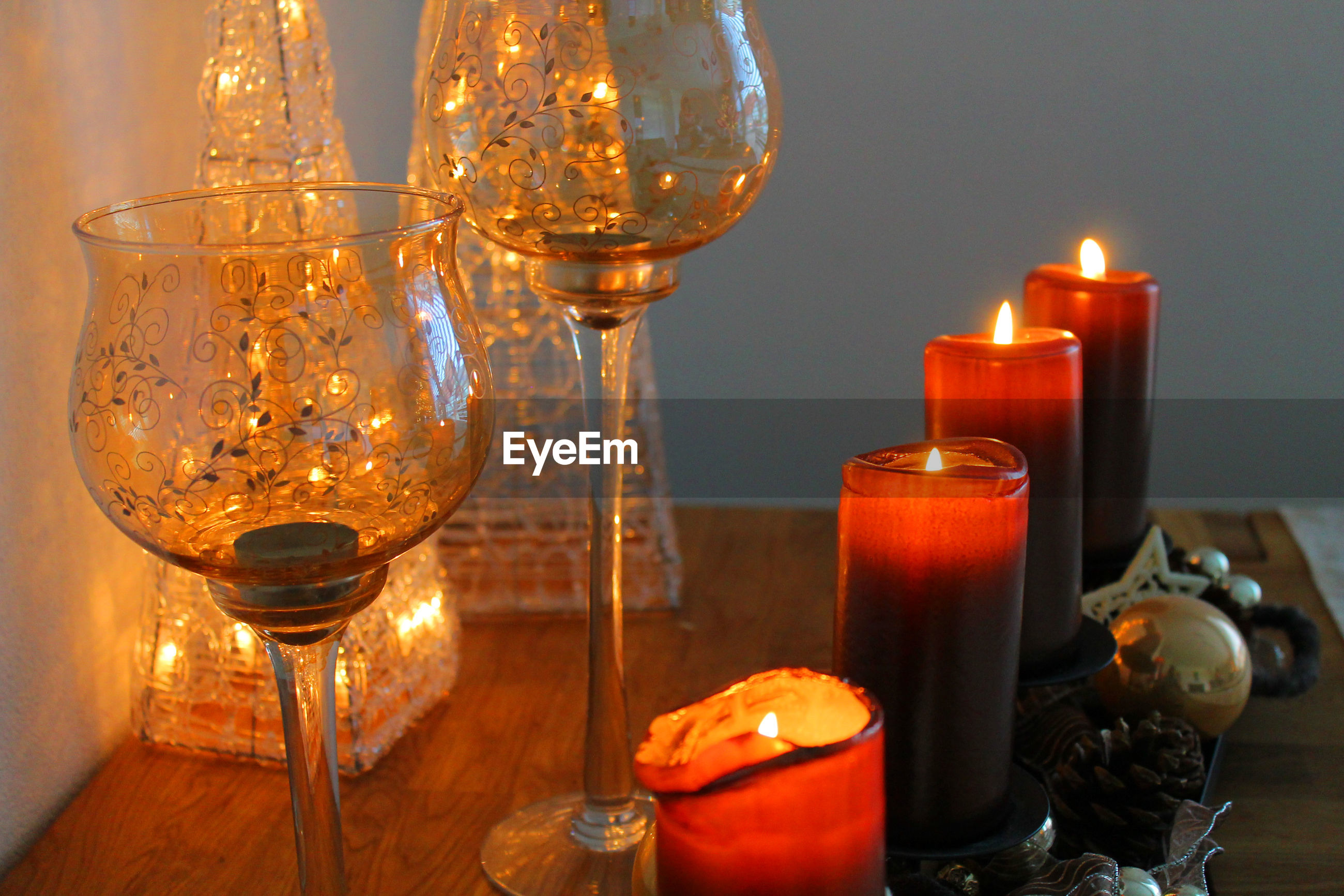 Close-up of lit light candles on table
