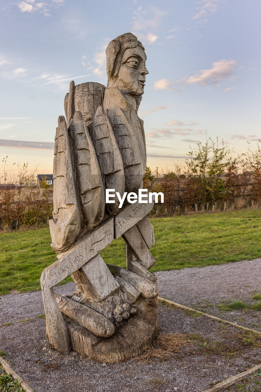art and craft, sculpture, representation, sky, statue, human representation, creativity, male likeness, no people, craft, nature, cloud - sky, stone material, grass, plant, solid, day, religion, outdoors, park, idol