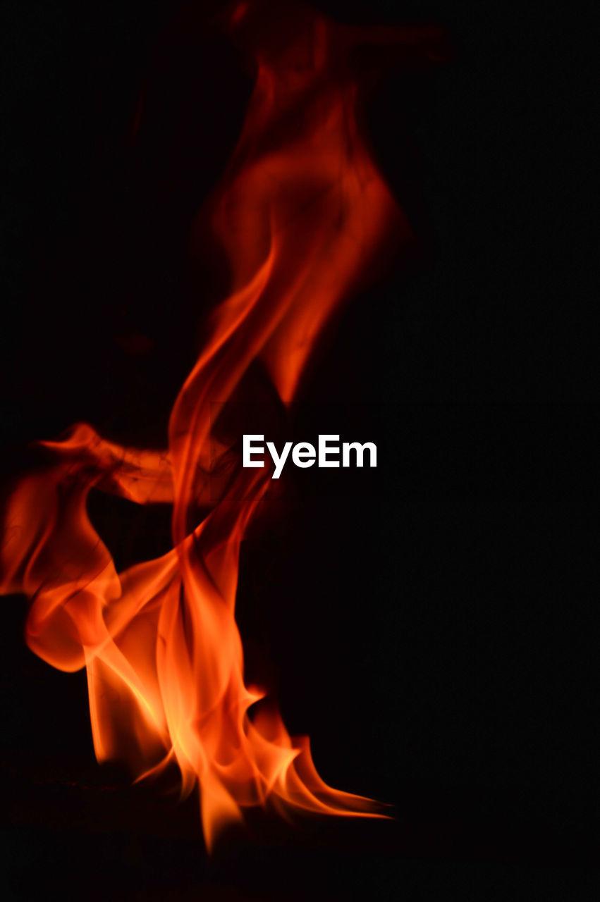 burning, flame, heat - temperature, orange color, close-up, smoke - physical structure, black background, night, studio shot, no people, bonfire, motion, indoors