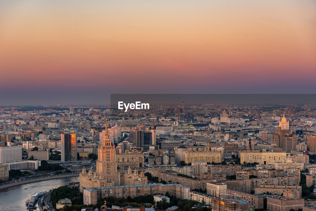 High Angle View Of Cityscape Against Orange Sky
