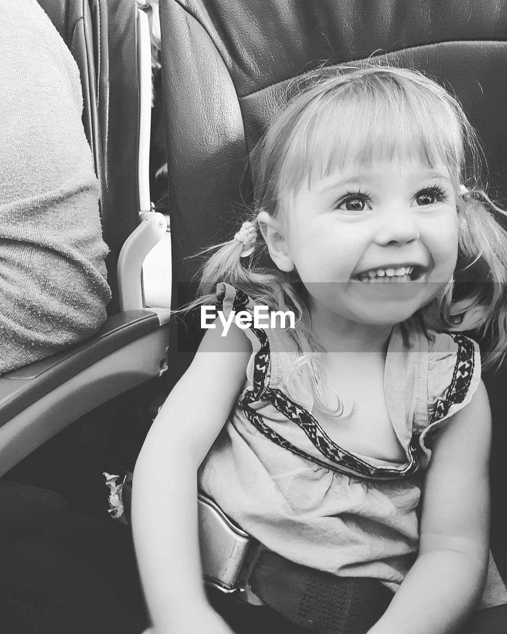 Smiling Cute Girl Sitting In Airplane
