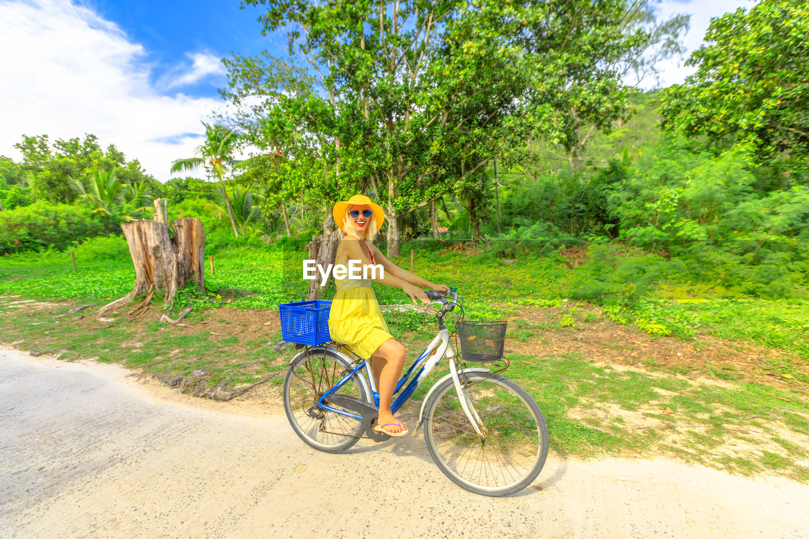 Woman riding bicycle on land