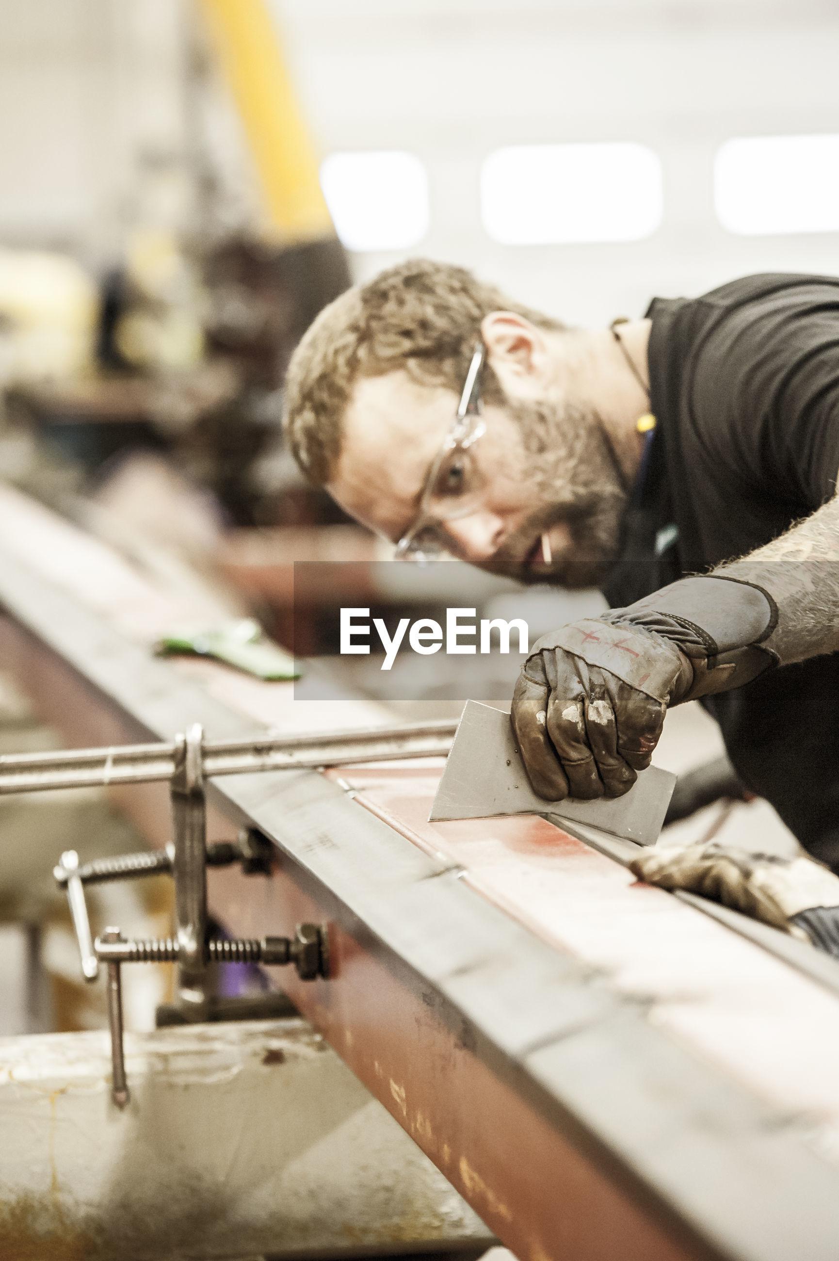 PORTRAIT OF MAN WORKING ON DISPLAY