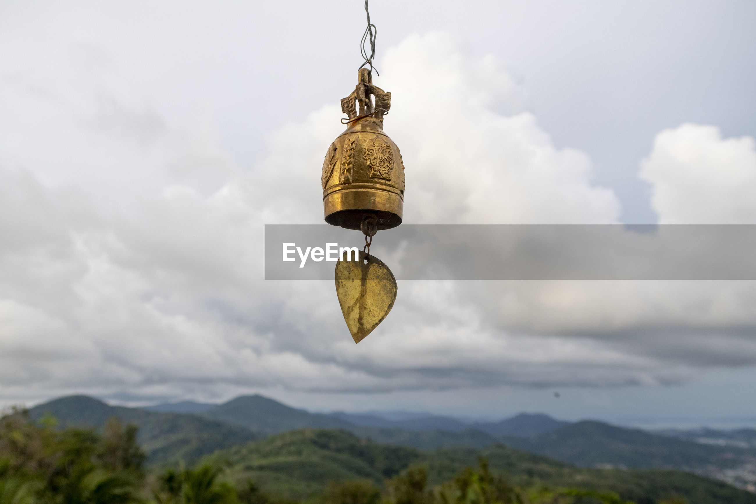 LOW ANGLE VIEW OF BELL HANGING AGAINST SKY