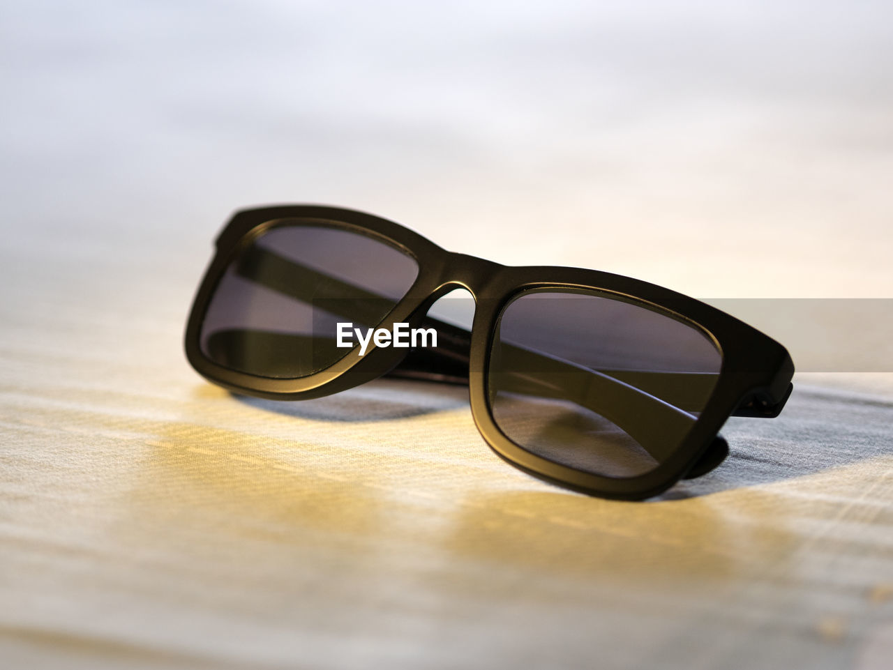 glasses, eyeglasses, sunglasses, fashion, transparent, personal accessory, still life, table, glass - material, security, close-up, no people, eyewear, protection, eyesight, selective focus, single object, reflection, focus on foreground, day, surface level