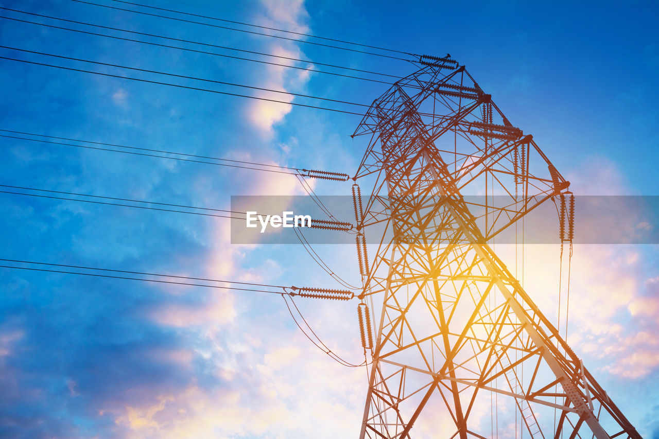 sky, low angle view, technology, connection, cloud - sky, electricity pylon, built structure, power supply, power line, nature, cable, electricity, fuel and power generation, no people, architecture, metal, blue, day, outdoors, tall - high, complexity, global communications, electrical equipment