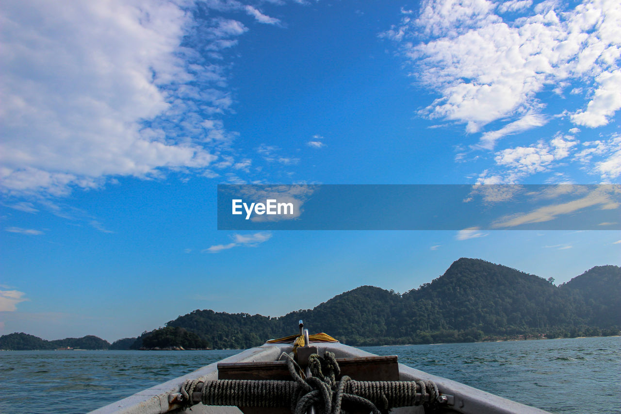 sky, cloud - sky, nature, water, beauty in nature, nautical vessel, day, mountain, sea, scenics, blue, mode of transport, transportation, outdoors, no people, tree, outrigger