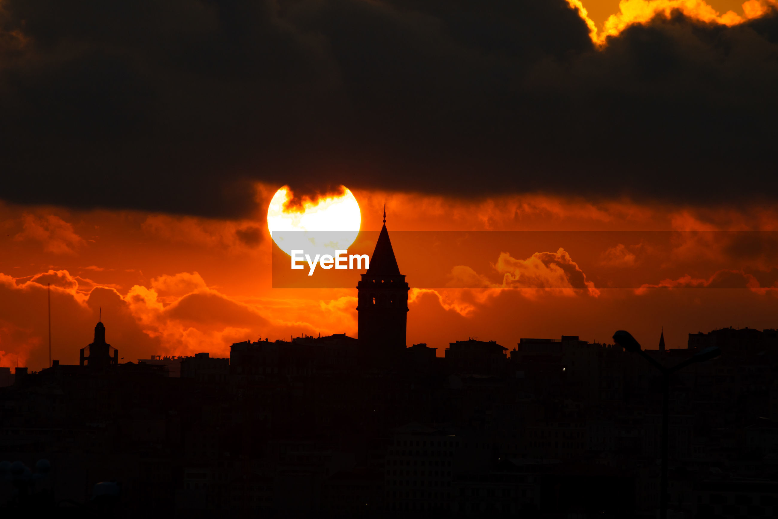 Sun and silhouette of galata tower