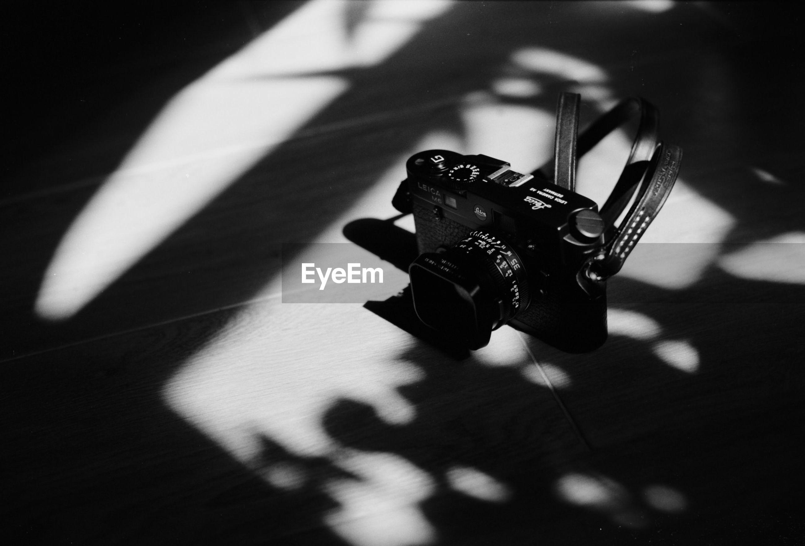 High angle view of camera on hardwood floor