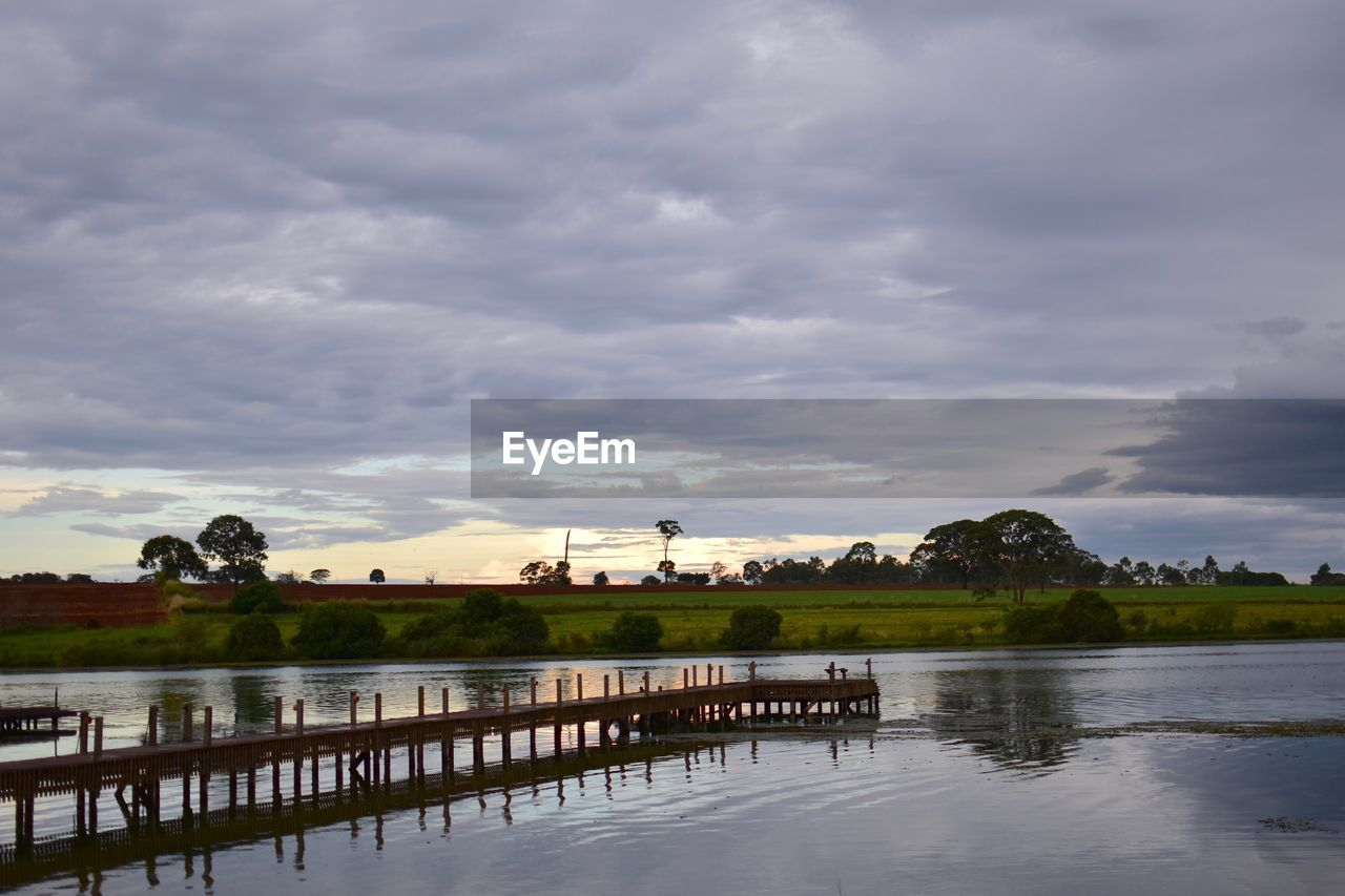 cloud - sky, sky, water, architecture, built structure, nature, no people, lake, building exterior, reflection, scenics - nature, beauty in nature, waterfront, tree, plant, day, building, outdoors, tranquil scene