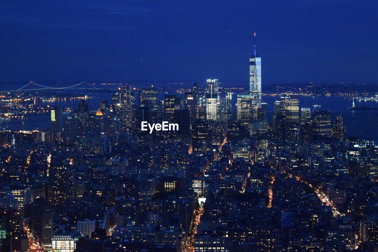 Aerial Shot Of Modern City Illuminated At Night