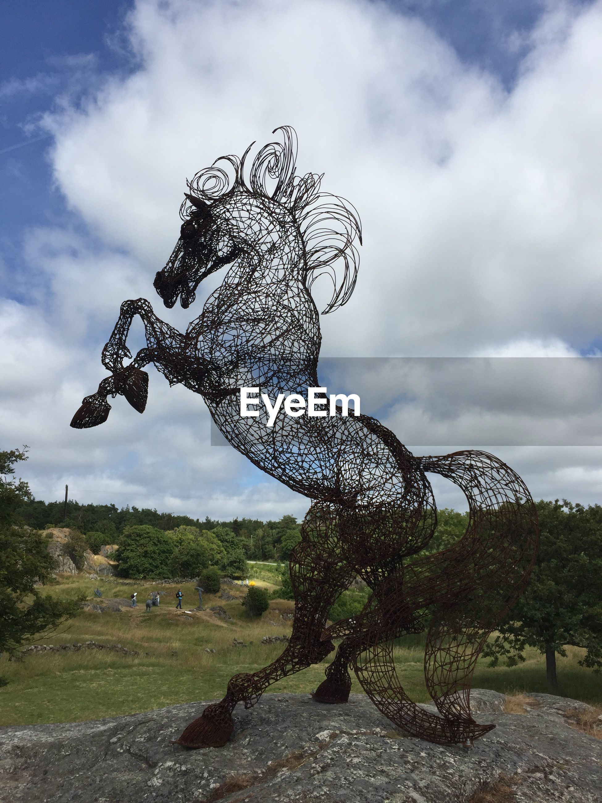 cloud - sky, sky, sculpture, art and craft, statue, animal representation, no people, day, outdoors, nature, beauty in nature