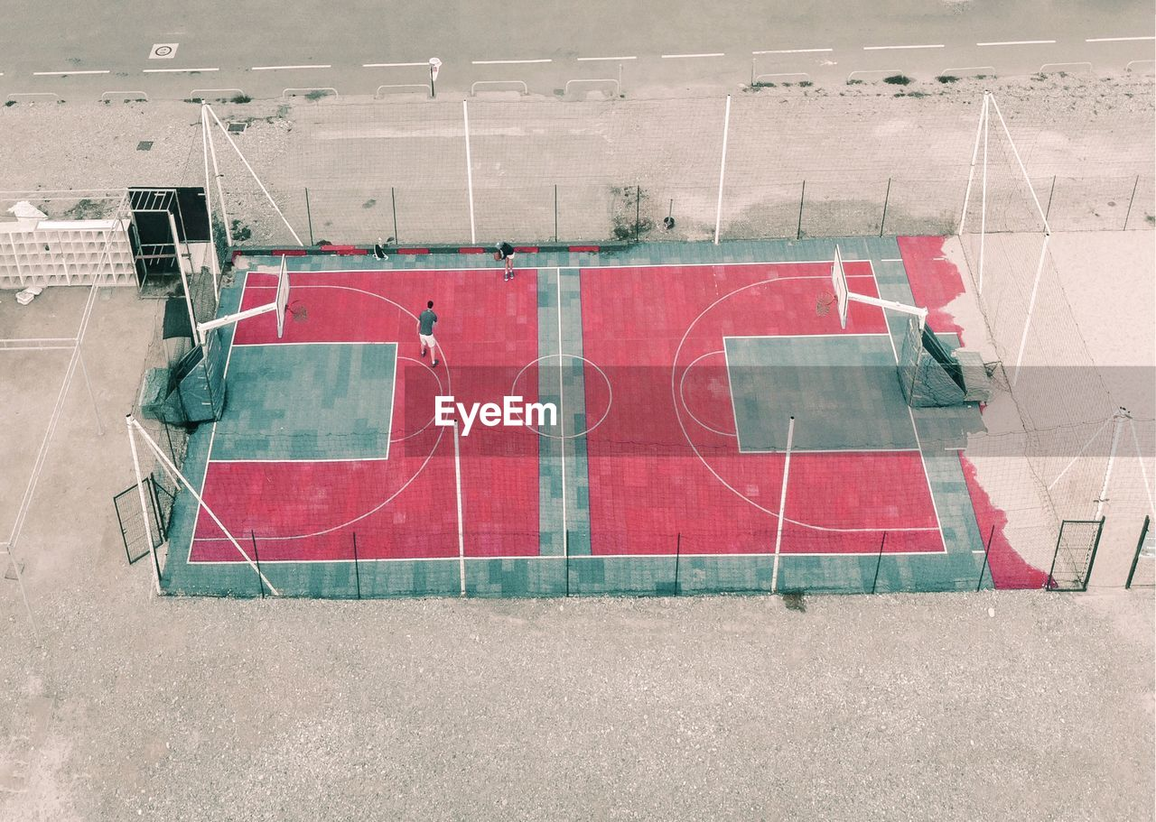 sport, red, high angle view, court, empty, day, absence, tennis, no people, competition, outdoors, playing field, nature, basketball - sport, soccer, competitive sport, sunlight, architecture, team sport, soccer field