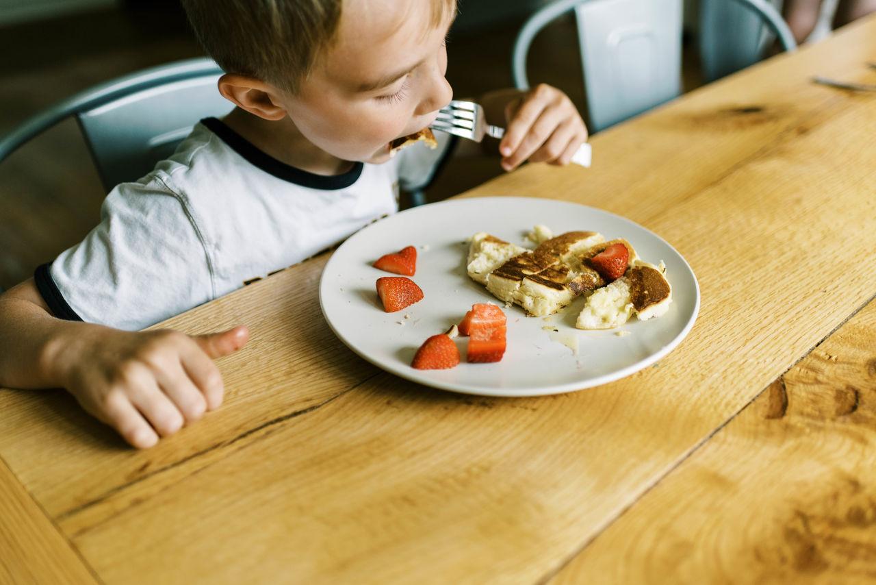 BOY EATING FOOD