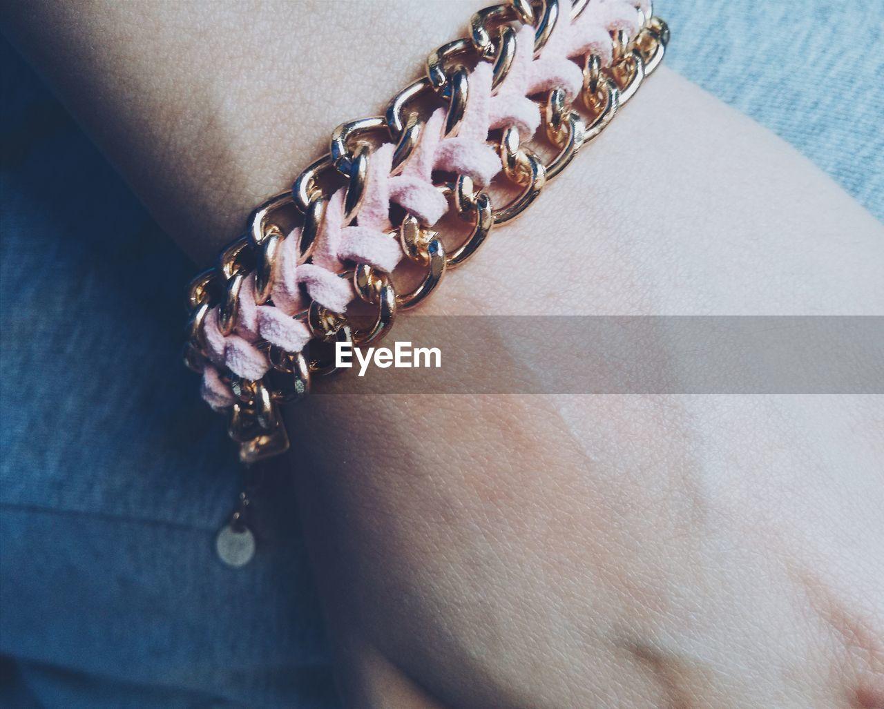 Close-up of bracelet on female hand