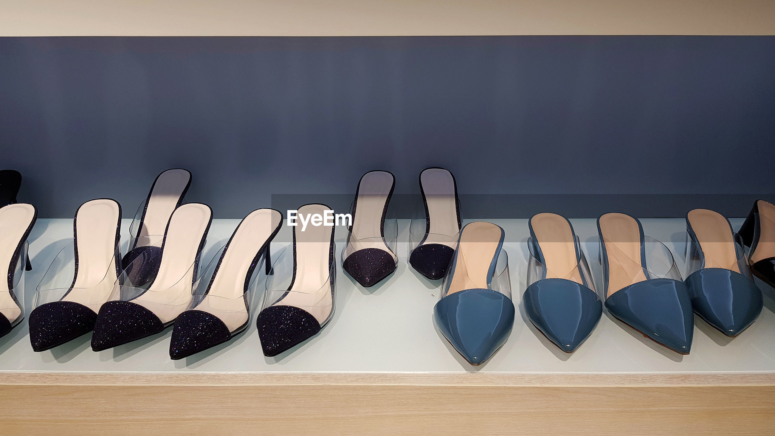 CLOSE-UP OF SHOES ARRANGED ON TABLE