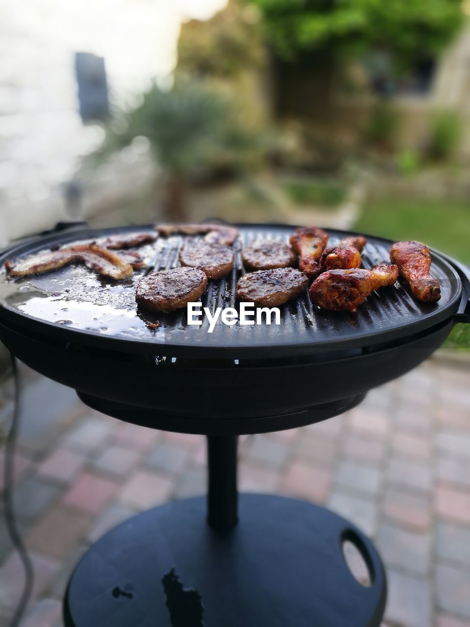 Chicken Being Cooked On Barbecue Grill In Back Yard
