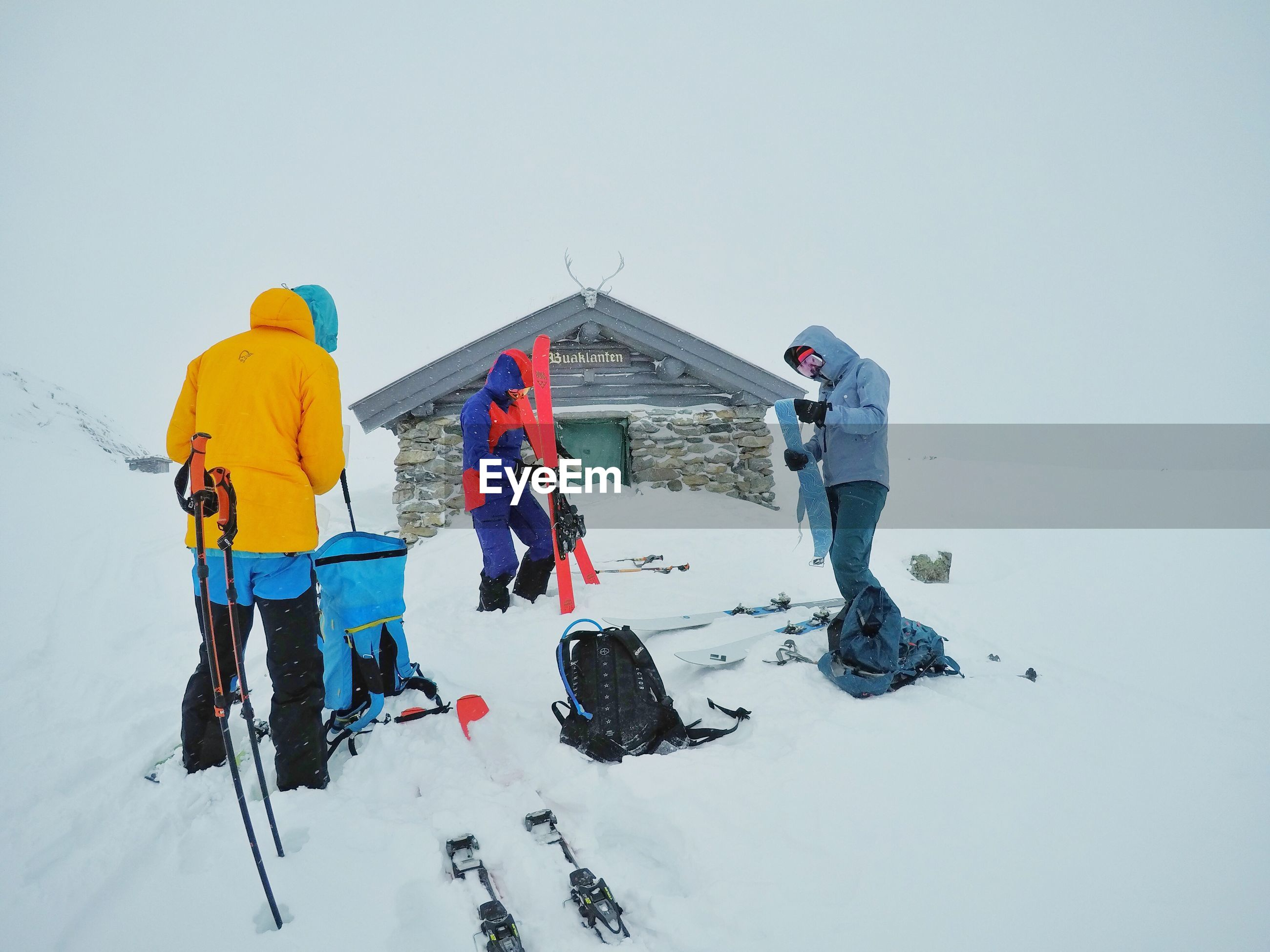 PEOPLE ON SNOW COVERED LAND
