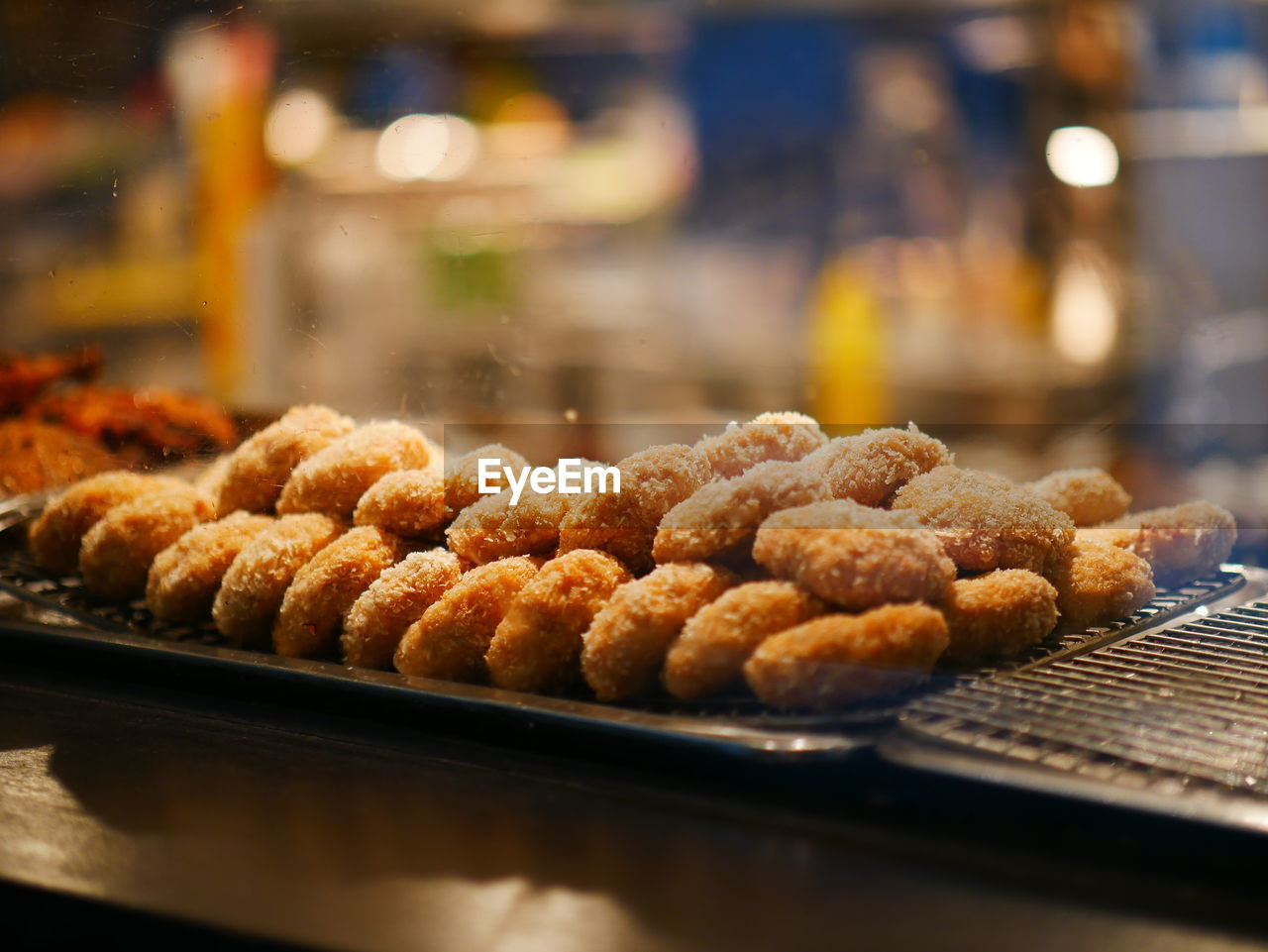 food, food and drink, freshness, selective focus, ready-to-eat, indoors, still life, close-up, no people, sweet food, table, focus on foreground, indulgence, unhealthy eating, temptation, deep fried, business, large group of objects, baked, for sale, snack, tray