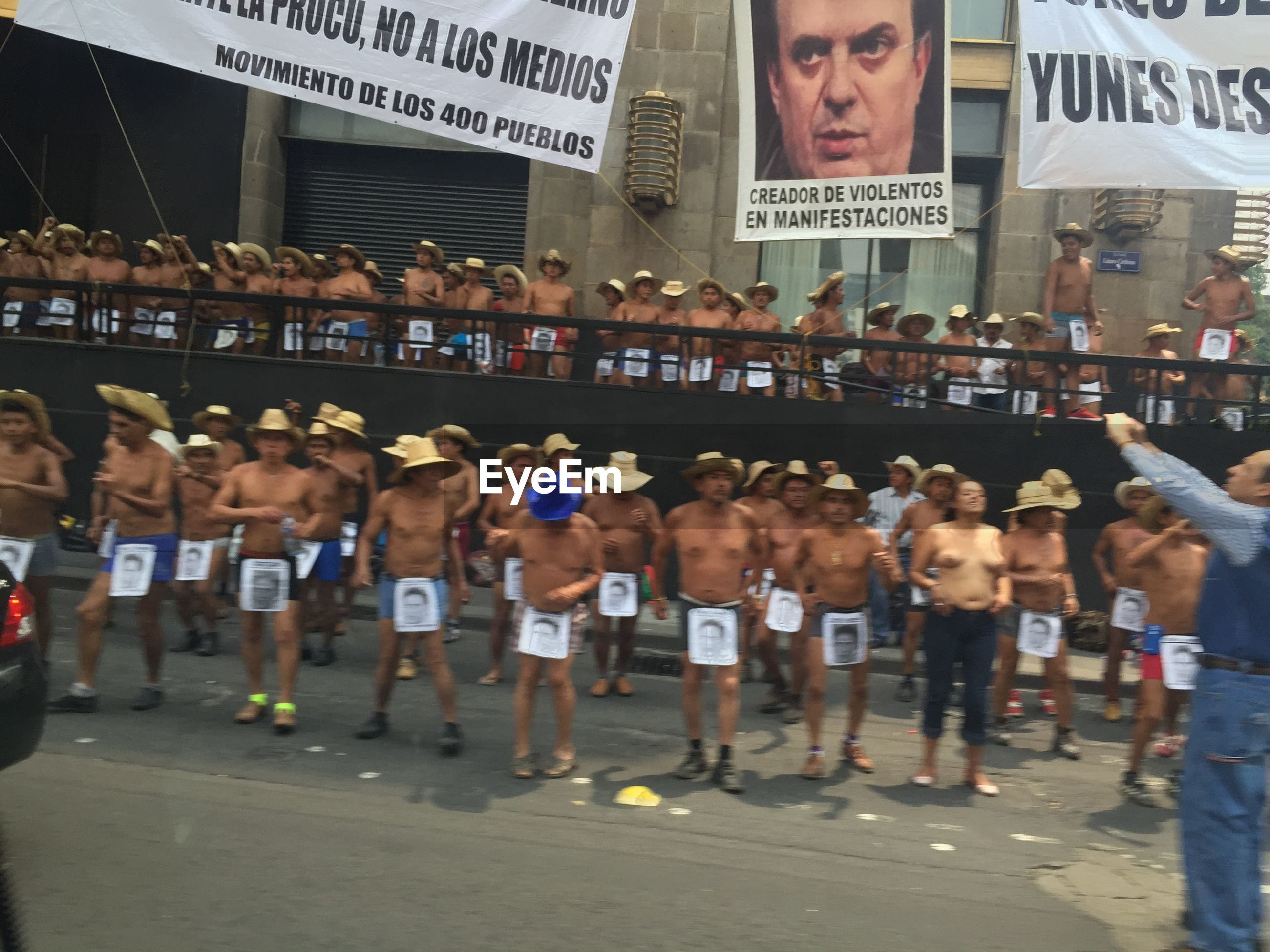 large group of people, text, crowd, real people, men, placard, day, sport, outdoors, city, adult, people