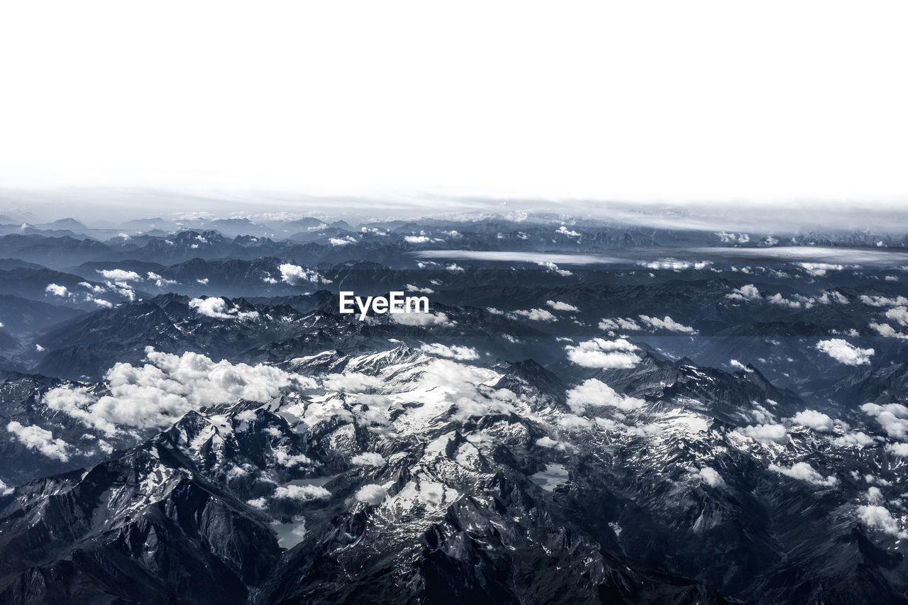 nature, beauty in nature, scenics, landscape, tranquil scene, outdoors, day, no people, mountain, aerial view, cold temperature, tranquility, fog, sky