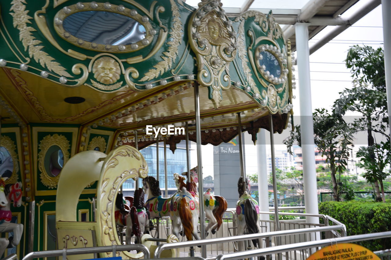 architecture, group of people, built structure, real people, arts culture and entertainment, women, amusement park, day, carousel, lifestyles, leisure activity, amusement park ride, men, art and craft, adult, outdoors, building, group, crowd, building exterior, ornate, architectural column