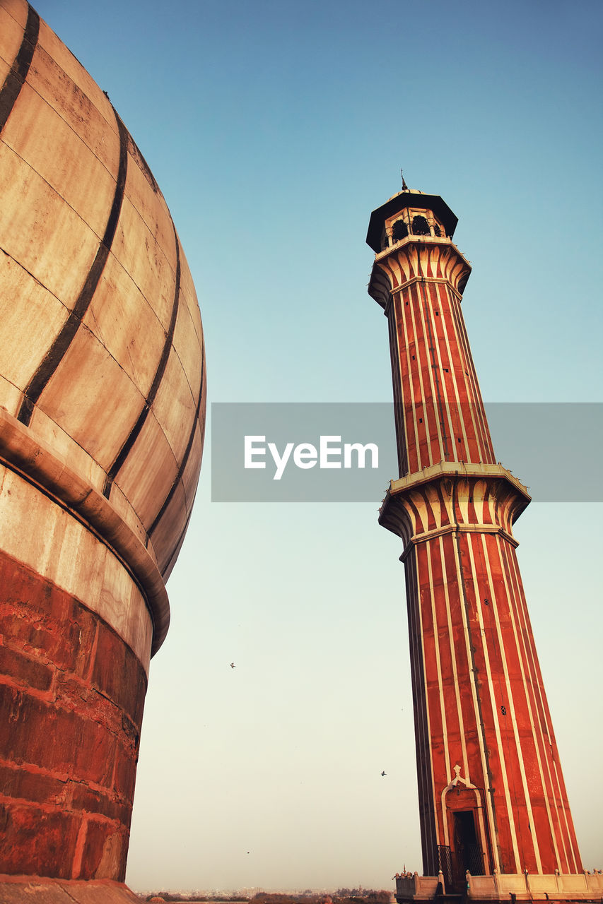 architecture, sky, built structure, low angle view, clear sky, architectural column, nature, tourism, travel destinations, building exterior, no people, travel, history, the past, tall - high, tower, day, city, outdoors, copy space, ancient civilization