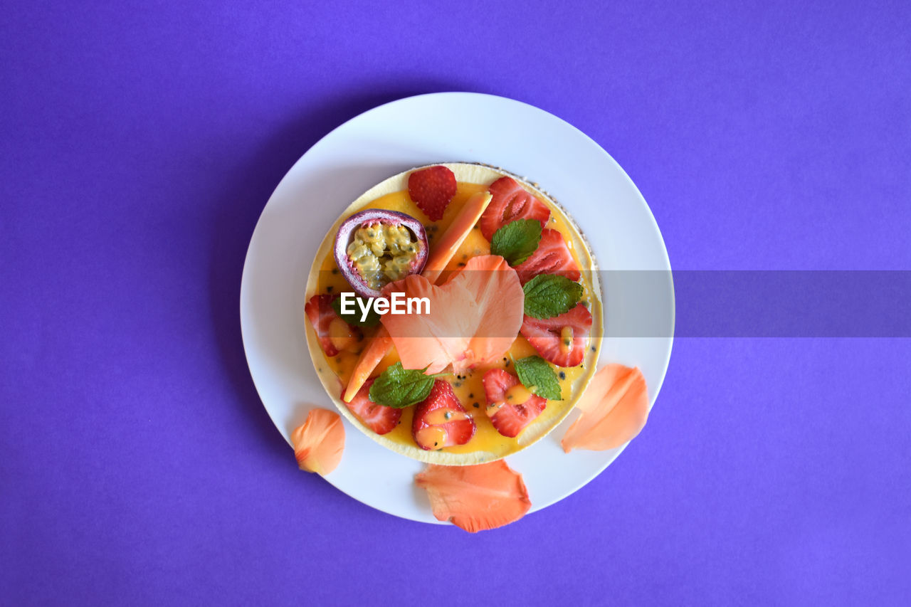 food and drink, food, freshness, directly above, indoors, ready-to-eat, wellbeing, plate, healthy eating, blue, colored background, studio shot, no people, serving size, still life, fruit, meat, vegetable, close-up, high angle view, blue background, garnish, temptation, snack