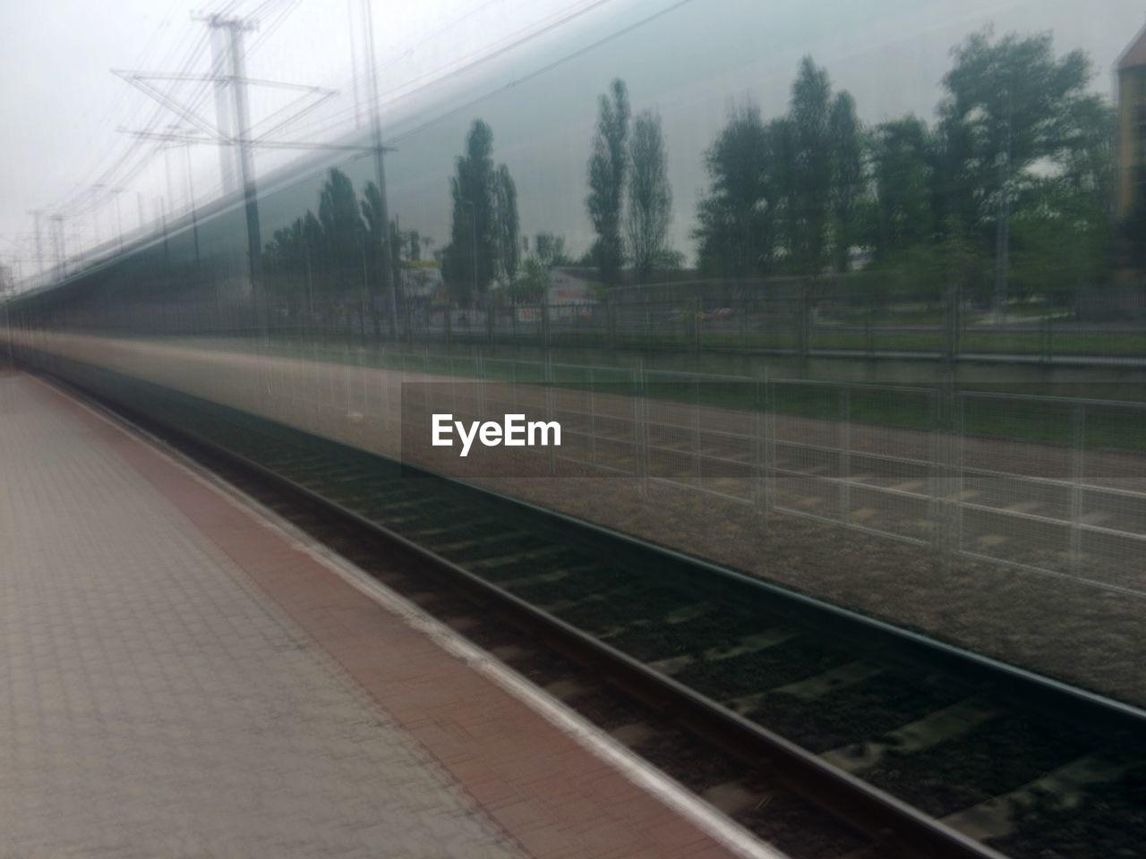 Speeding blurred train at railway station