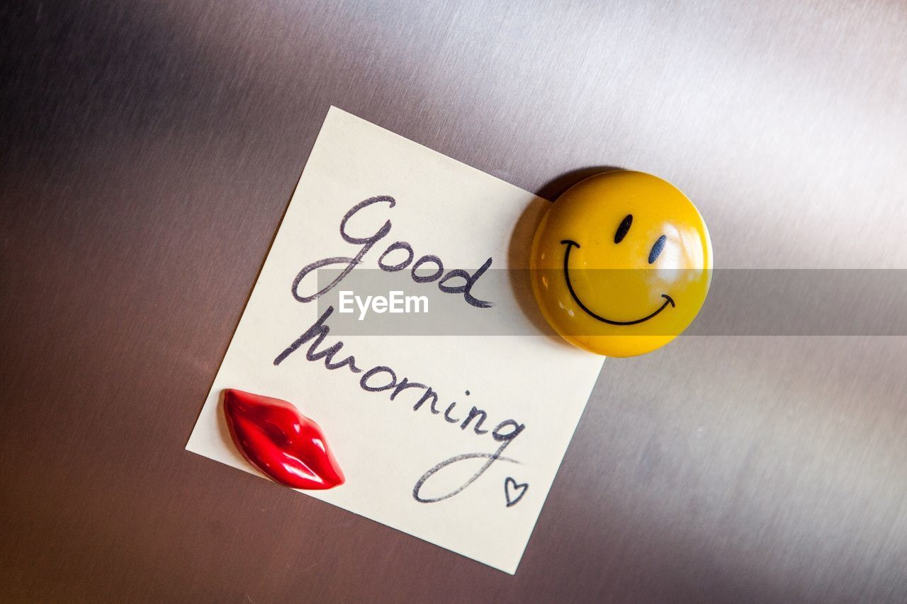 Close-Up Of Good Morning Text And Smiley Face Badge | on EyeEm