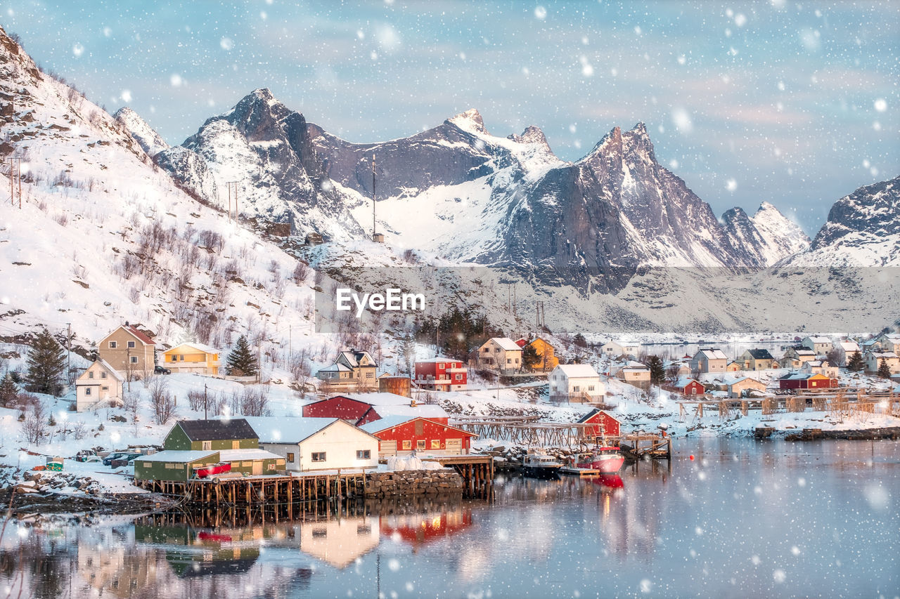 mountain, winter, cold temperature, snow, building exterior, architecture, building, water, scenics - nature, mountain range, built structure, beauty in nature, reflection, snowcapped mountain, house, nature, residential district, city, no people, outdoors, mountain peak