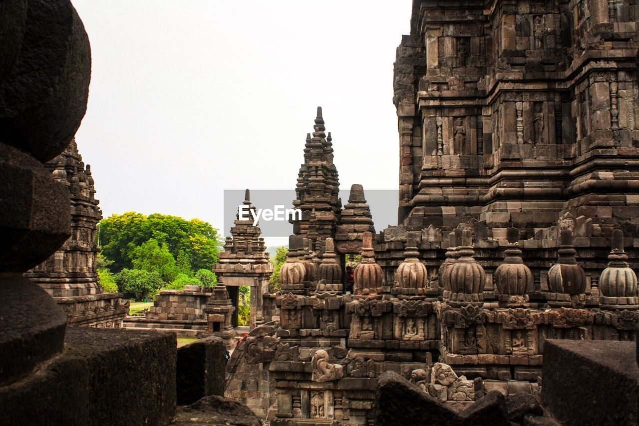 place of worship, religion, history, spirituality, architecture, ancient civilization, built structure, ancient, travel destinations, building exterior, no people, day, clear sky, outdoors, sky