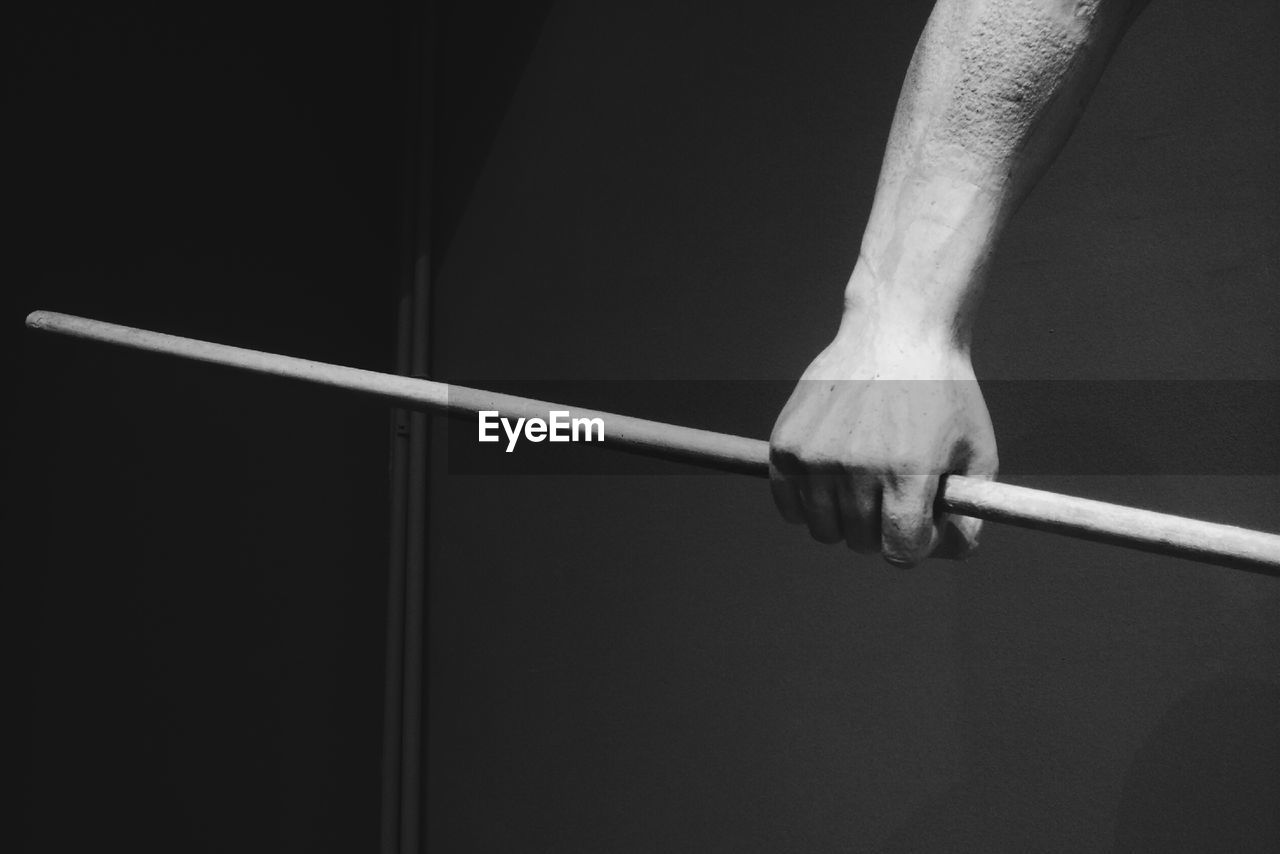 real people, one person, human body part, human hand, sport, indoors, men, hand, body part, lifestyles, skill, low section, holding, unrecognizable person, leisure activity, close-up, practicing, exercising, rope, human limb