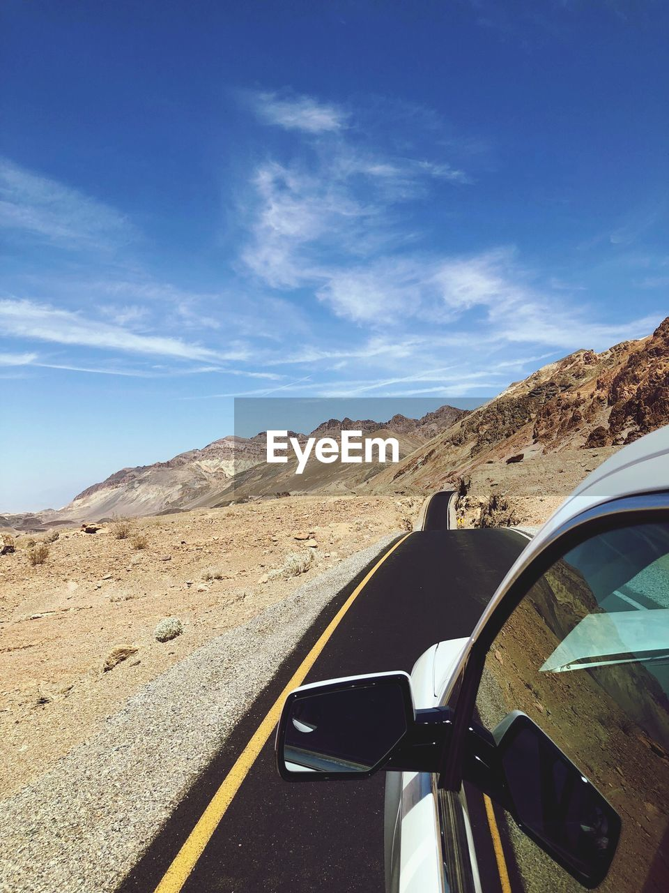 Car on road against mountains and sky