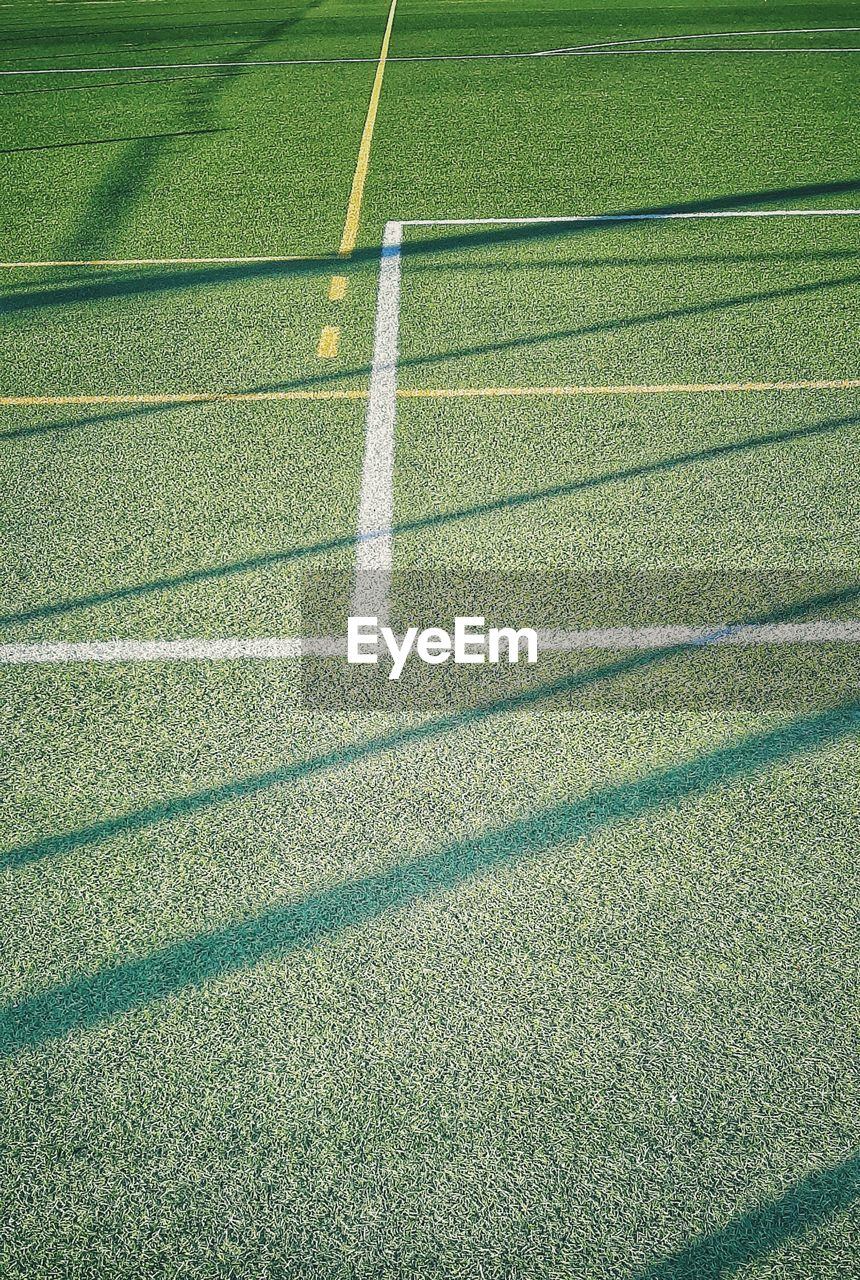 HIGH ANGLE VIEW OF SOCCER FIELD WITH SHADOW ON BACKGROUND