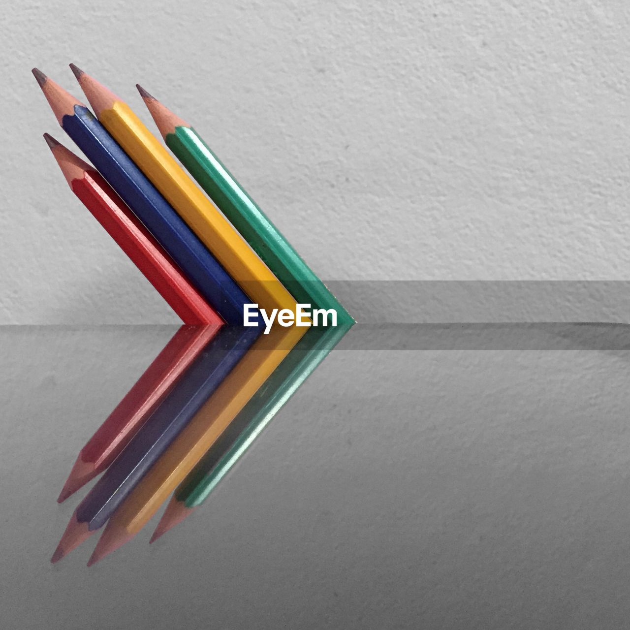 HIGH ANGLE VIEW OF COLORFUL PENCILS ON WHITE BACKGROUND