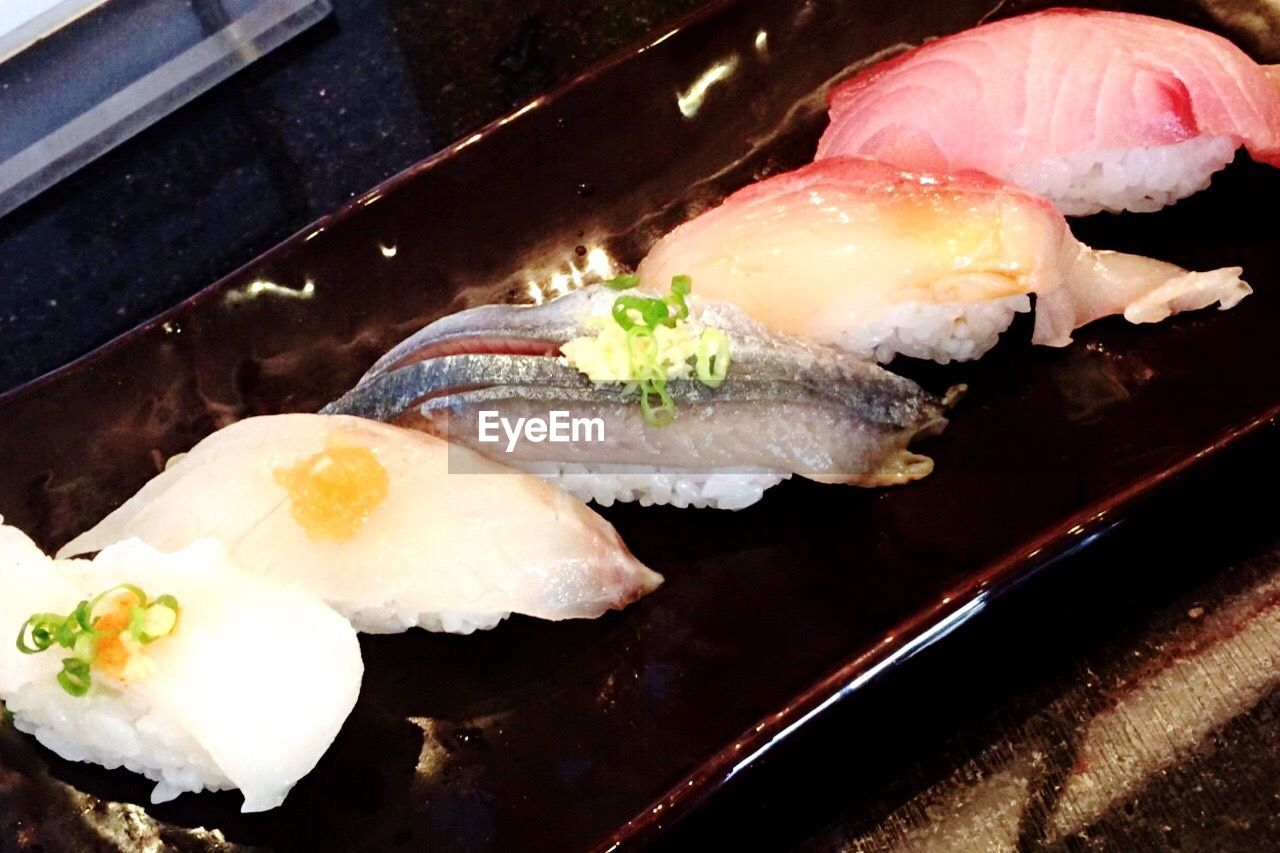 food and drink, seafood, sushi, japanese food, food, healthy eating, freshness, sashimi, no people, ready-to-eat, high angle view, indoors, close-up, day