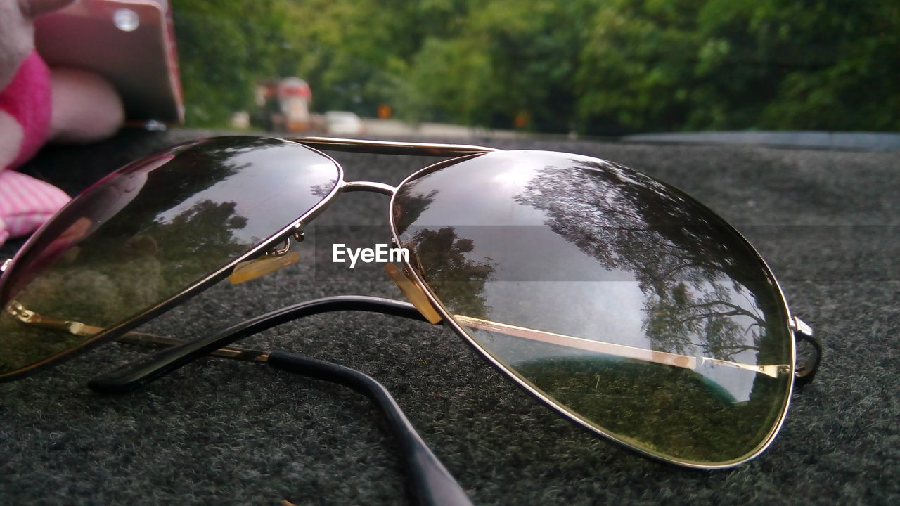 sunglasses, reflection, day, no people, focus on foreground, outdoors, close-up, eyeglasses, tree, nature