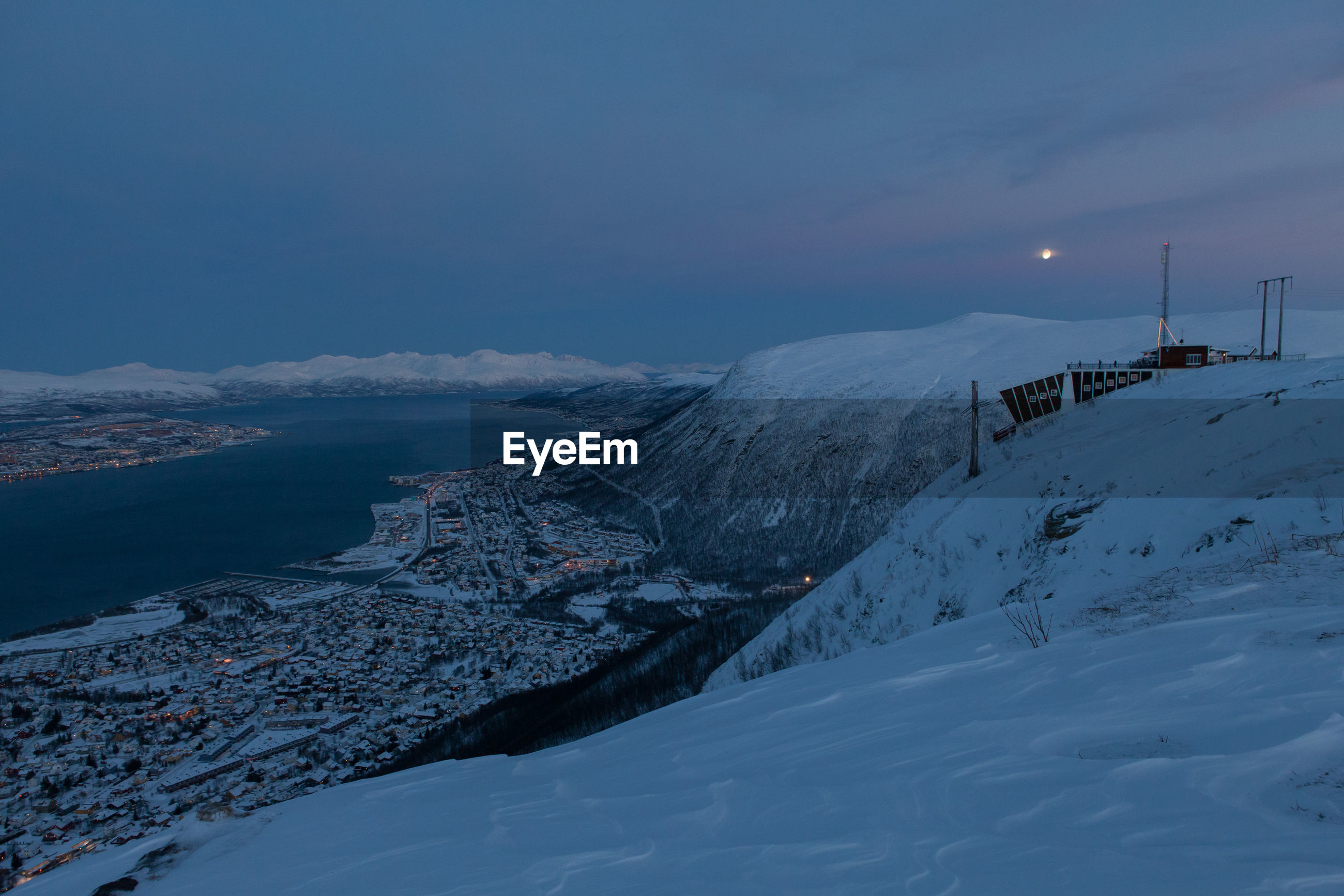 Town By Fjord Against Sky Seen From Mountain Peak