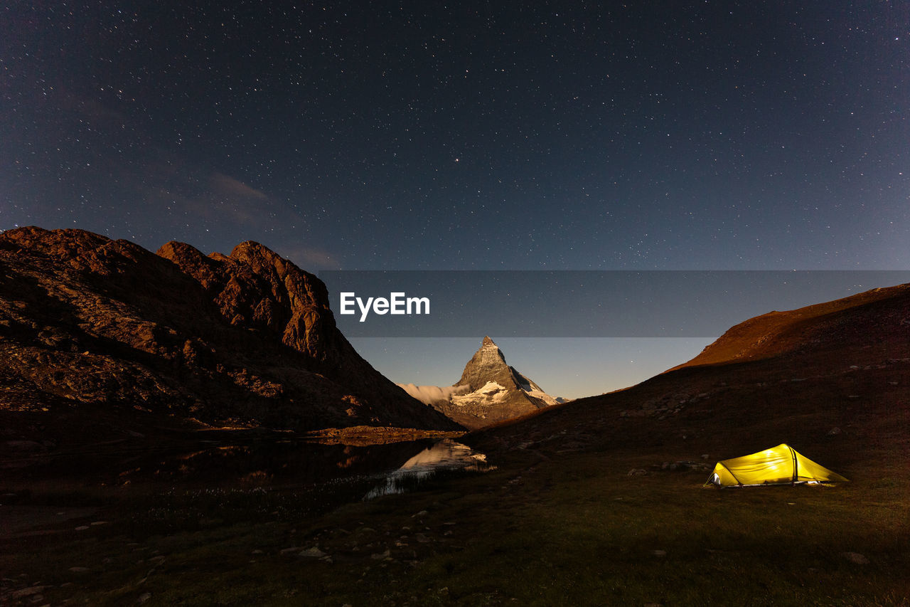 Scenic View Of Mountain Range Against Star Field