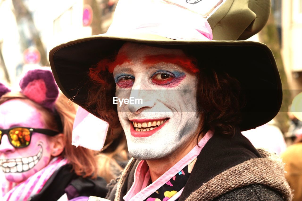 Close-up portrait of smiling man with face paint during carnival