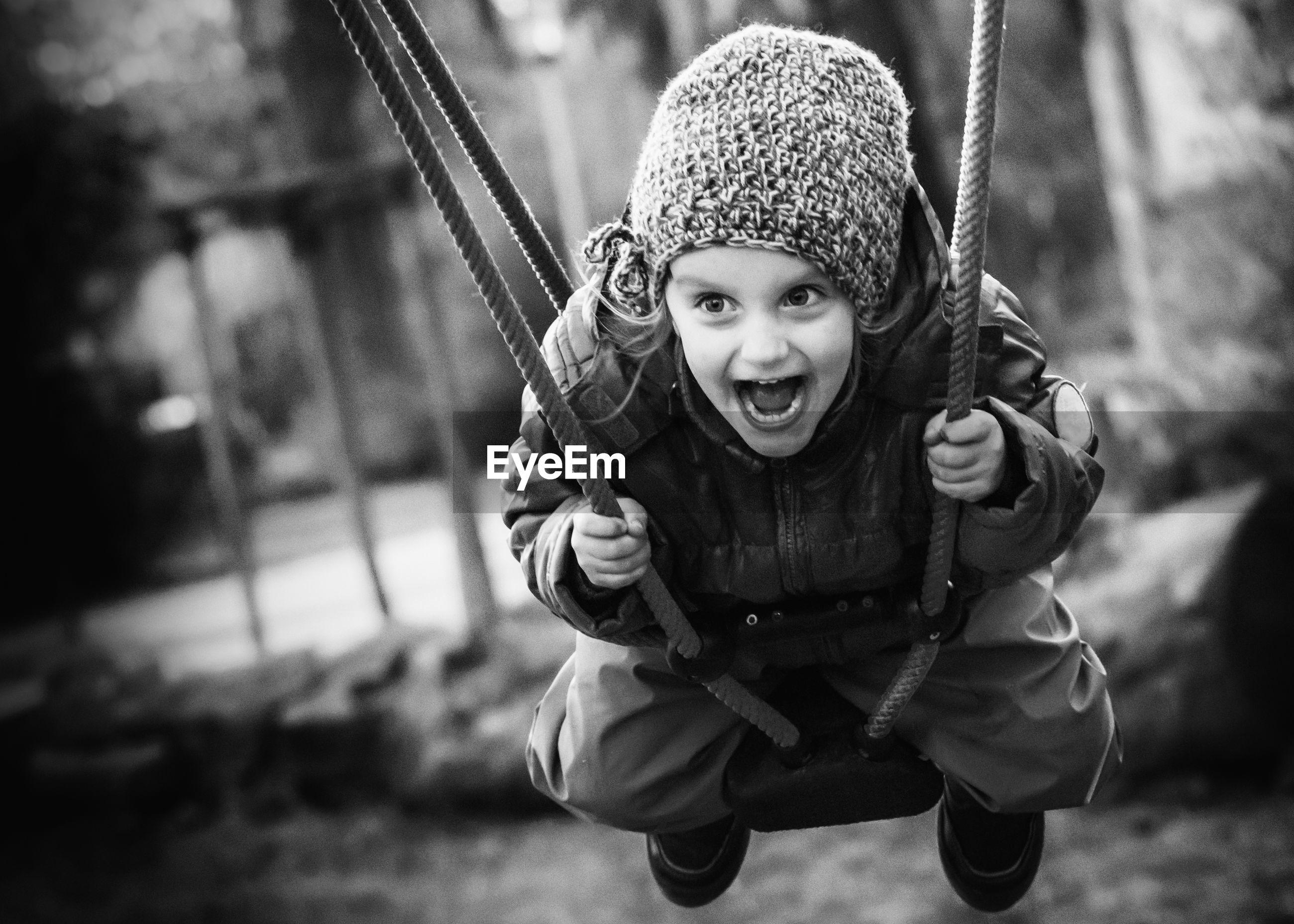 Cute girl swinging at playground
