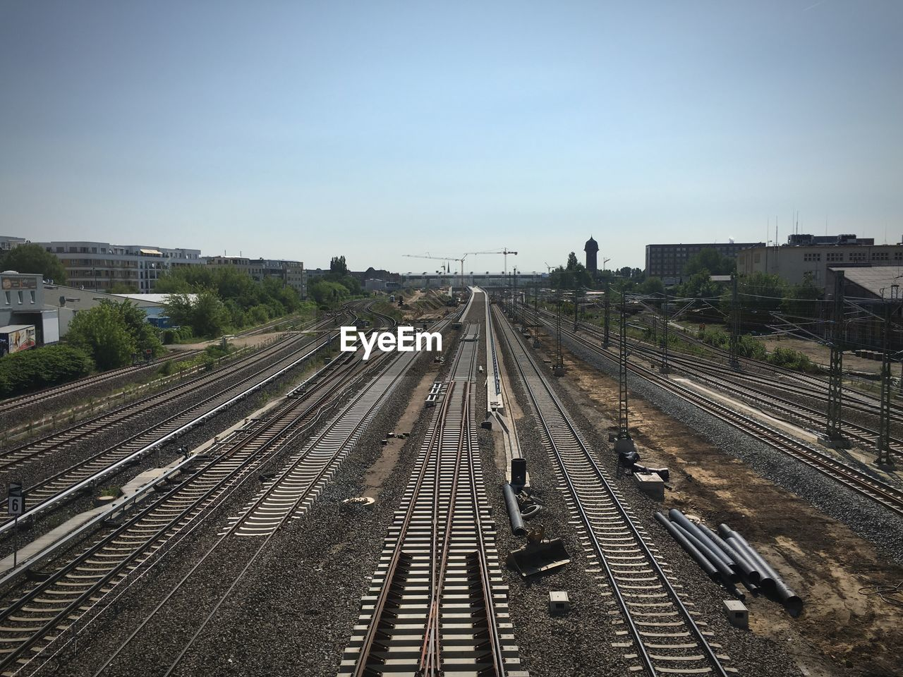 High angle view of empty railroad tracks in city against sky
