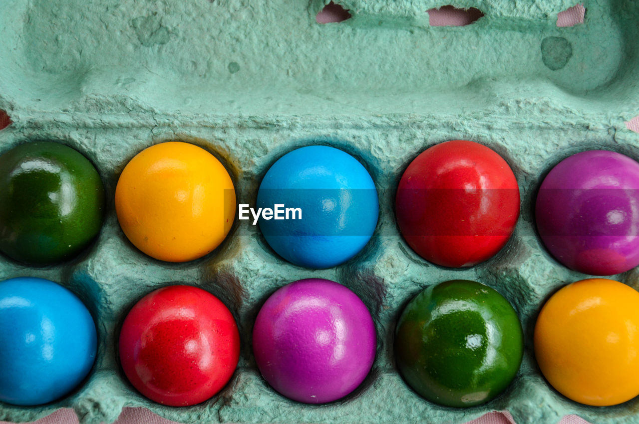 Close-up of colorful easter eggs in carton