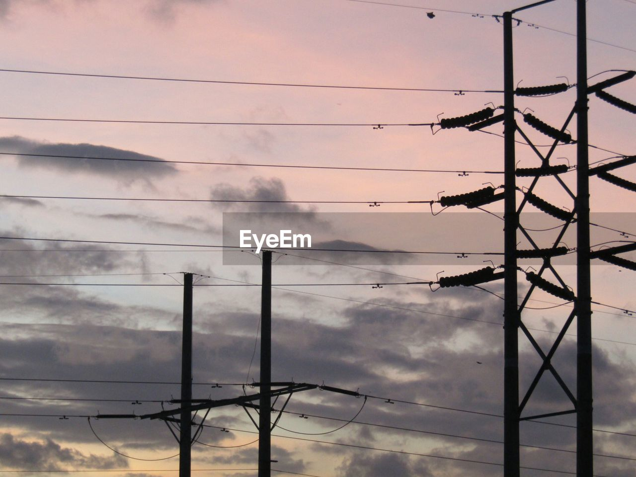 cable, electricity, power line, sky, cloud - sky, technology, connection, fuel and power generation, power supply, electricity pylon, nature, no people, low angle view, sunset, smoke - physical structure, silhouette, outdoors, environmental issues, pollution, power, air pollution, telephone line, complexity, electrical equipment