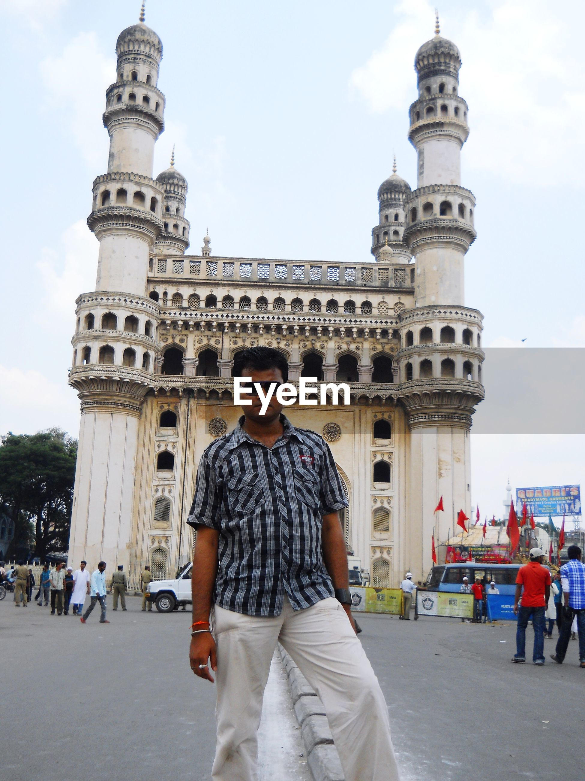 Full length of man standing at historic building against sky