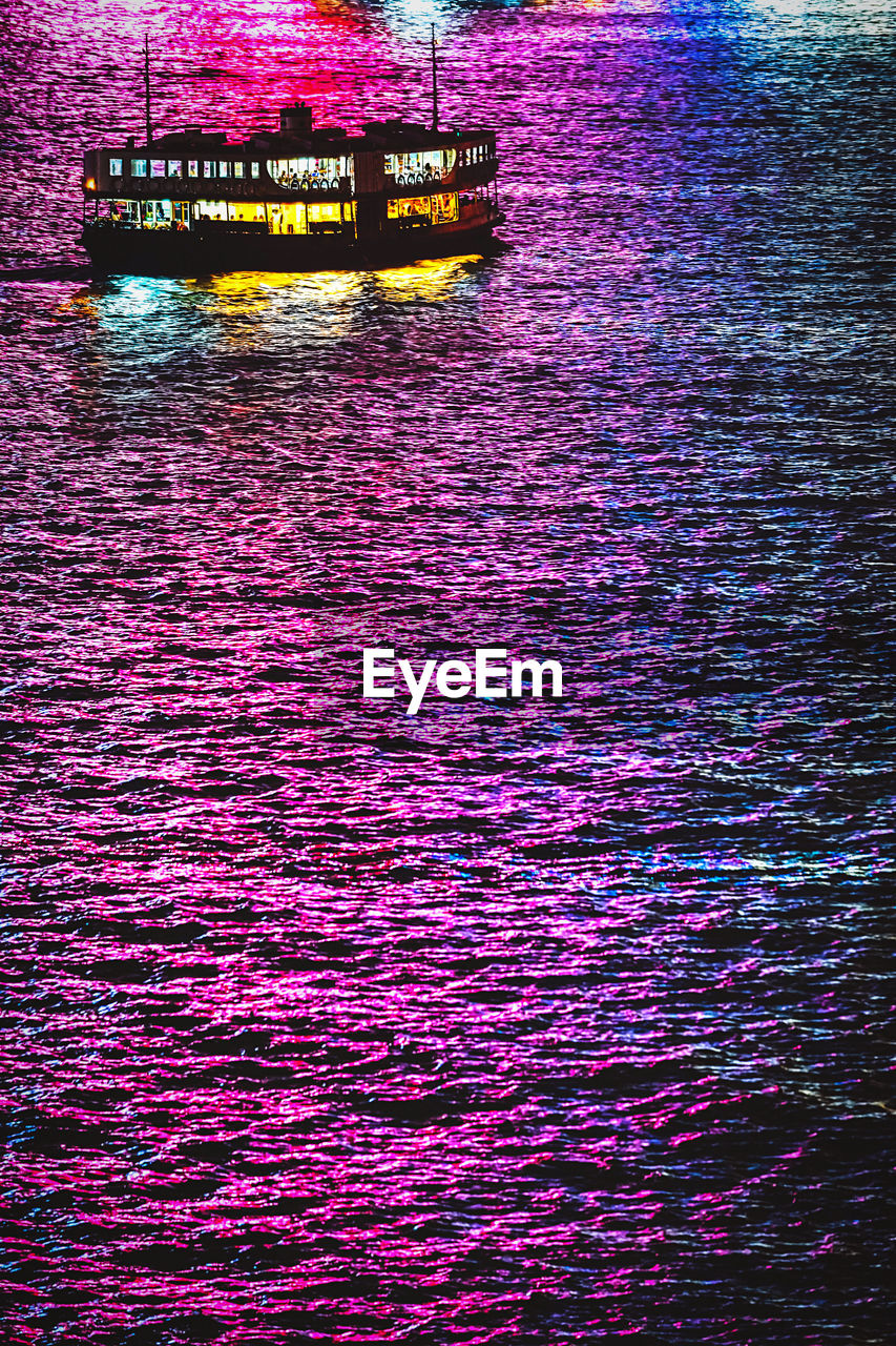water, waterfront, nautical vessel, no people, rippled, transportation, nature, river, reflection, outdoors, mode of transportation, purple, multi colored, day, beauty in nature, illuminated, architecture, business