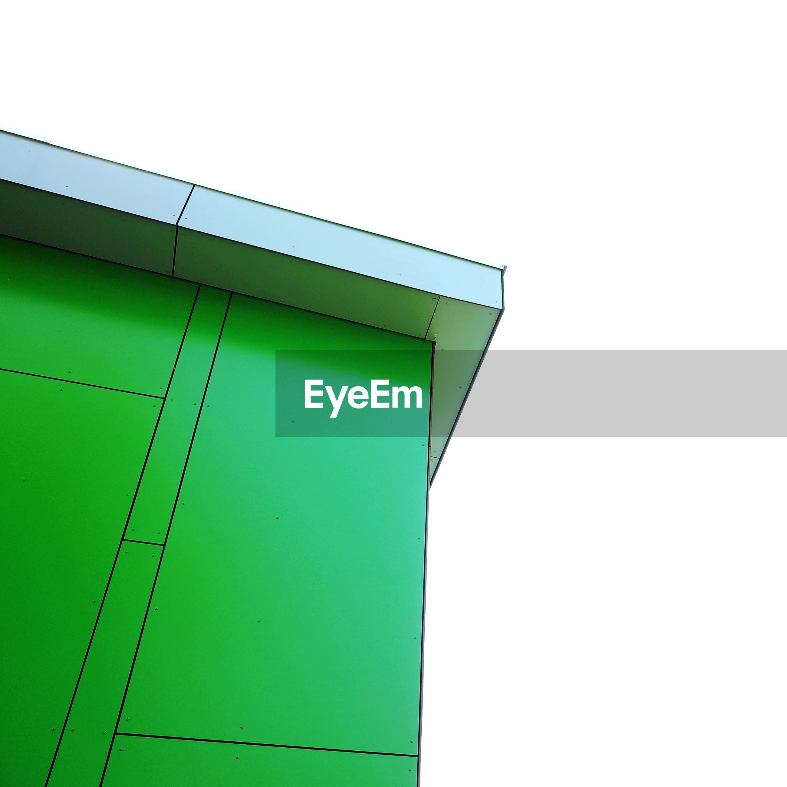 Low angle view of green building against clear sky